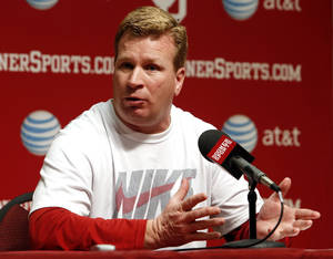 photo - Mike Stoops talks with the press before the start of Spring Football at the University of Oklahoma (OU) on Thursday, March 7, 2013 in Norman, Okla.  Photo by Steve Sisney, The Oklahoman