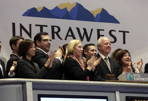 Photo - Intrawest Resorts Holdings CEO William Jensen, second from right, is applauded as he rings the New York Stock Exchange opening bell, to mark his company's IPO, Friday, Jan. 31, 2014. Denver-based Intrawest is a mountain resort and adventure company. (AP Photo/Richard Drew)