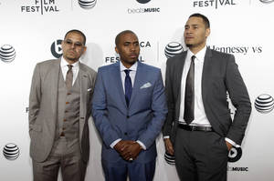 From left, director One9, recording artist Nas and writer Erik Parker attend the world premiere of Time Is Illmatic at the 2014 Tribeca Film Festival on Wednesday, April 16, 2014, in New York. (Photo by Andy Kropa/Invision/AP)