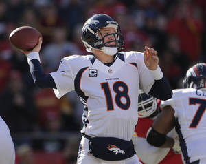 Photo -   Denver Broncos quarterback Peyton Manning (18) passes during the first half of an NFL football game against the Kansas City Chiefs at Arrowhead Stadium in Kansas City, Mo., Sunday, Nov. 25, 2012. (AP Photo/Charlie Riedel)