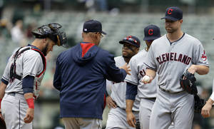 Photo - Cleveland Indians' Corey Kluber, right, hands the ball to manager Terry Francona as he is removed from the baseball game against the Oakland Athletics in the fourth inning Wednesday, April 2, 2014, in Oakland, Calif. (AP Photo/Ben Margot)