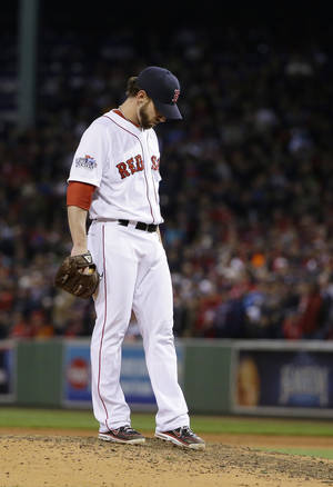 Photo - Boston Red Sox relief pitcher Craig Breslow waits to be taken out during the seventh inning of Game 2 of baseball's World Series against the St. Louis Cardinals Thursday, Oct. 24, 2013, in Boston. (AP Photo/Matt Slocum)