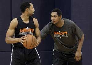 Photo -   Charlotte Bobcats' Boris Diaw, right, of France, guards Gerald Henderson, left, during practice for the NBA basketball team in Charlotte, N.C., Tuesday, Dec. 13, 2011. Coach Paul Silas says 6-foot-8 Boris Diaw will replace Kwame Brown as the Bobcats' starting center this season if they don't sign another big man. (AP Photo/Chuck Burton)