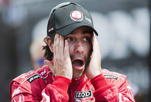 Photo - Dario Franchitti, of Scotland, wipes his face after winning the pole position for the first of two weekend IndyCar races, Friday, July 12, 2013 in Toronto. (AP Photo/The Canadian Press, Mark Blinch)