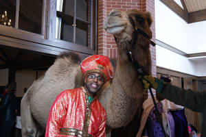 Photo - Bruce Plummer, dressed as one of the Three Wise Men, poses for a picture with one of the camels that took part in the Epiphany service at St. Augustine of Canterbury Episcopal Church in Oklahoma City. Photo provided by Crystal Plummer <strong></strong>