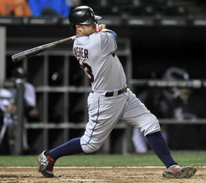 Photo - Cleveland Indians' NIck Swisher watches his two RBI-single during the fifth inning of a baseball game against the Chicago White Sox in Chicago, Thursday, Sept. 12, 2013. (AP Photo/Paul Beaty)