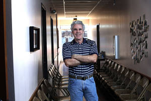 photo - Dr. Fred Loper stands in a hallway at the Good Shepherd Ministries free clinic in Oklahoma City. Photo by Sarah Phipps, The Oklahoman  <strong>SARAH PHIPPS - SARAH PHIPPS</strong>
