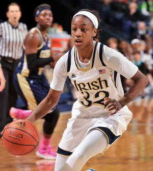 Photo - Notre Dame guard Jewell Loyd drives the lane during  the first half of an NCAA college basketball game against Georgia Tech, Monday, Feb. 17, 2014, in South Bend, Ind. (AP Photo/Joe Raymond)