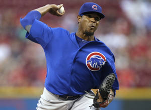 Photo - Chicago Cubs starting pitcher Edwin Jackson throws against the Cincinnati Reds in the first inning of a baseball game, Tuesday, Sept. 10, 2013, in Cincinnati. (AP Photo/Al Behrman)