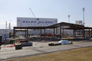 Photo - Work continues on the renovation of Ralph Wilson Stadium, home of the NFL football team Buffalo Bills, in Orchard Park, N.Y., Thursday, April 10, 2014. The new team store is being constructed in the foreground. Don't rule out Niagara Falls as a potential future home of the Bills. Several officials told The Associated Press that a newly formed Bills stadium task force of public and private leaders seeking to bolster the team's long-term viability is considering sites that would put it closer to the team's burgeoning Ontario fan base. The stadium is currently undergoing $130 million in upgrades.  (AP Photo/Bill Wippert)