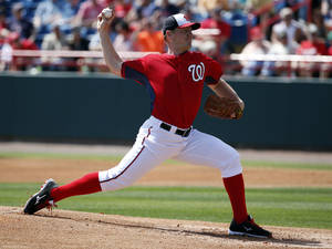Photo - Washington Nationals starting pitcher Jordan Zimmermann throws in the first inning of a spring exhibition baseball game against the Atlanta Braves, Saturday, March 1, 2014, in Viera, Fla. (AP Photo/Alex Brandon)