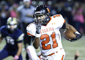 photo - Norman's Imond Robinson breaks loose on a long run against Southmoore during the first half in Moore, Friday  October 12, 2012. Photo By Steve Gooch, The Oklahoman
