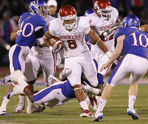 Photo - Oklahoma's Dominique Whaley (8) runs through the Kansas defense during the college football game between the University of Oklahoma Sooners (OU) and the University of Kansas Jayhawks (KU) on Saturday, Oct. 15, 2011. in Lawrence, Kan. Photo by Chris Landsberger, The Oklahoman
