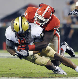 Photo -   Vanderbilt wide receiver Jordan Matthews (87) is brought down by Georgia linebacker Amarlo Herrera (52) during the second half of an NCAA college football game on Saturday, Sept. 22, 2012, in Athens, Ga. (AP photo/John Amis)