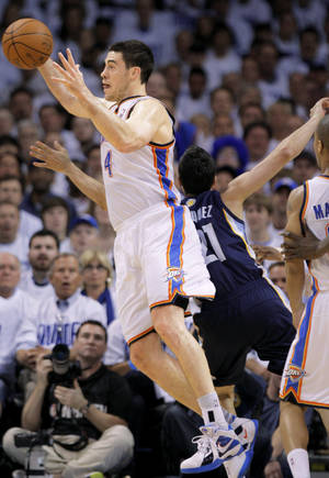 photo - OKC's Nick Collison, left, grabs a rebound in front of Memphis' Greivis Vasquez during Game 5 of the Western Conference semifinals on May 11.  Photo by Bryan Terry, The Oklahoman