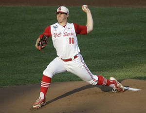 Photo - FILE - In this June 20, 2013 file photo, North Carolina State pitcher Carlos Rodon throws against North Carolina during an NCAA College World Series elimination baseball game in Omaha, Neb. The Houston Astros are on the clock to lead off the Major League Baseball draft for the third straight year Thursday night June 5, 2014. Houston has a few options with the first pick, including a pair of California high school stars in left-hander Brady Aiken and catcher-outfielder Alex Jackson, and North Carolina State lefty Carlos Rodon. (AP Photo/Nati Harnik, File)