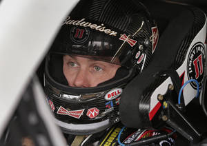 Photo - Kevin Harvick waits for practice for Saturday's NASCAR Sprint Cup Series auto race at Charlotte Motor Speedway in Concord, N.C., Thursday, Oct. 10, 2013. (AP Photo/Chuck Burton)