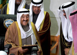 "photo - The Amir of Kuwait, Sheikh Sabah Al Sabah, left, receives a copy of a speech given by Kuwait's Prime Minister, Sheikh Jaber al-Mubarak al-Sabah, second right, during the inauguration of the 14th Legislative Term of the National Assembly in Kuwait, Sunda,  Dec 16, 2012. Security forces blocked hundreds of protesters from staging a rally outside the parliament building Sunday, as Kuwait's amir denounced anti-government factions as committing ""treason"" and vowed to stand firm amid the country's deepening political crisis. (AP Photo/Gustavo Ferrari)"