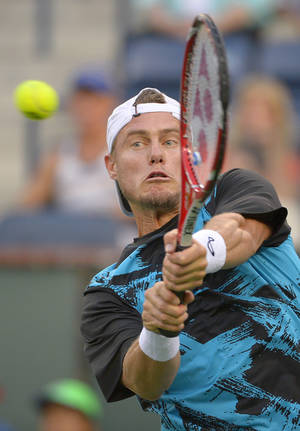 Photo - Lleyton Hewitt, of Australia, returns a shot against Matthew Ebden, of Australia, during a first round match at the BNP Paribas Open tennis tournament, Thursday, March 6, 2014, in Indian Wells, Calif. (AP Photo/Mark J. Terrill)