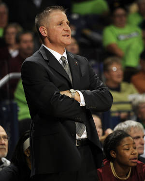 Photo - Boston College coach Erik Johnson watches his team in the first half of an NCAA college basketball game with Notre Dame, Thursday, Jan. 9, 2014 in South Bend, Ind. (AP Photo/Joe Raymond)