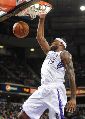 Photo - DeMarcus Cousins of the Sacramento Kings scores on a fast break play against the Boston Celtics  during an NBA basketball game on Sunday, Dec. 30, 2012 at Sleep Train Arena in Sacramento, Calif. (AP Photo/ The Sacramento Bee, Hector Amezcua)MANDATORY CREDIT