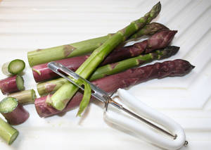 Photo - Spring rains may make it necessary to use a vegetable peeler to remove some of the lower leaflets along asparagus stems. These tend to pick up tiny bits of soil during heavy spring rains as the asparagus works its way up through the soil. Trim the bottoms of the asparagus to keep the spears at a uniform length then use the peeler to slice away the leaflets before cooking.     <strong>SHERREL JONES - THE OKLAHOMAN</strong>