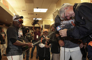 Photo -   San Francisco Giants' Pablo Sandoval, left, sprays Champagne during a television interview after the Giants defeated the San Diego Padres to win the National League West Division title after a baseball game, Saturday, Sept 22, 2012, in San Francisco. The Giants won 8-4. (AP Photo/Ben Margot, Pool)