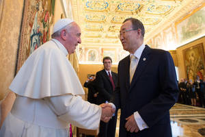 """Photo - In this photo provided by the Vatican newspaper L'Osservatore Romano, Pope Francis greets U.N. Secretary-General Ban Ki-moon at the Vatican, Friday, May 9, 2014. Pope Francis called Friday for governments to redistribute wealth to the poor in a new spirit of generosity to help curb the """"economy of exclusion"""" that is taking hold today. Francis made the appeal during a speech to U.N. Secretary-General Ban Ki-moon and the heads of major U.N. agencies who are meeting in Rome this week. Latin America's first pope has frequently lashed out at the injustices of capitalism and the global economic system that excludes so much of humanity. (AP Photo/L'Osservatore Romano)"""