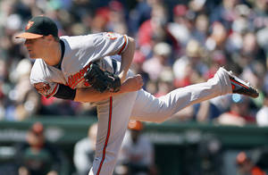 Photo - Baltimore Orioles' Bud Norris follows through on a pitch in the first inning of a baseball game against the Boston Red Sox in Boston, Saturday, April 19, 2014. (AP Photo/Michael Dwyer)