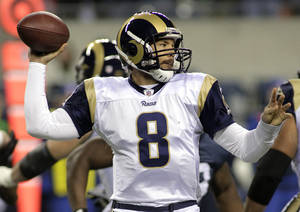 Photo - St. Louis Rams quarterback Sam Bradford sets to pass in the first half of an NFL football game against the Seattle Seahawks, Monday, Dec. 12, 2011, in Seattle. (AP Photo/Ted S. Warren) ORG XMIT: SEA104