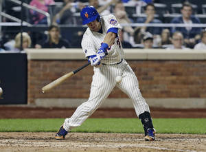 Photo - New York Mets' Taylor Teagarden hits a grand slam home run during the sixth inning of a baseball game against the Milwaukee Brewers, Tuesday, June 10, 2014, in New York. (AP Photo/Frank Franklin II)