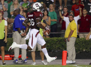 Photo -   South Carolina free safety, D.J. Swearinger crosses the goal line for a touchdown following a fumble recovery during the first half of an NCAA college football game against UAB at Williams-Brice Stadium in Columbia, S.C., Saturday, Sept. 15, 2012. (AP Photo/Brett Flashnick)