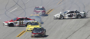 Photo - Trevor Bayne (21) and Brad Keselowski (2) are sideways after colliding with cars during the NASCAR Aaron's 499 Sprint Cup series auto race at Talladega Superspeedway, Sunday, May 4, 2014, in Talladega, Ala. (AP Photo/John Bazemore)