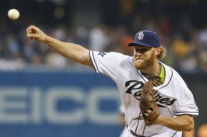 Photo - San Diego Padres starting pitcher Andrew Cashner works against the Detroit Tigers during the first inning of a baseball game Friday, April 11, 2014, in San Diego. (AP Photo/Lenny Ignelzi)