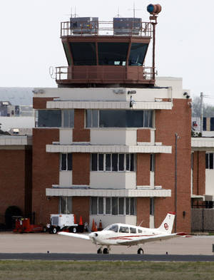Photo - The air traffic control tower at the University of Oklahoma's Max Westheimer Airport is active on Thursday, April 4, 2013 in Norman.  Photo by Steve Sisney, The Oklahoman <strong>STEVE SISNEY</strong>