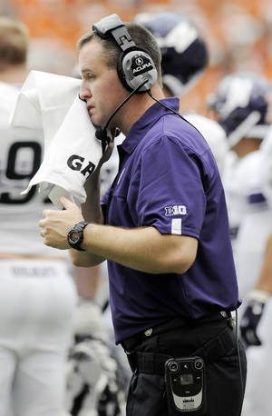 Photo -   Northwestern head coach Pat Fitzgerald coaches his team against Syracuse during the fourth quarter of an NCAA college football game in Syracuse, N.Y., Saturday, Sept. 1, 2012. Northwestern won 42-41. (AP Photo/Hans Pennink)