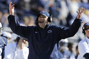 photo -   Penn State head coach Bill O&#039;Brien gestures toward an official during the first quarter of an NCAA college football game against Indiana in State College, Pa., Saturday, Nov. 17, 2012. (AP Photo/Gene J. Puskar)  