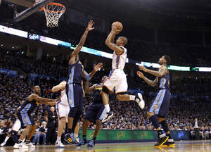 photo - Oklahoma City's Eric Maynor (6) shoots a layup during the NBA basketball game between the Denver Nuggets and the Oklahoma City Thunder in the first round of the NBA playoffs at the Oklahoma City Arena, Wednesday, April 27, 2011. Photo by Sarah Phipps, The Oklahoman