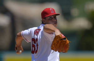 Photo - Los Angeles Angels starting pitcher Jason Vargas throws to the plate during the first inning of their baseball game against the Los Angeles Angels, Sunday, Aug. 18, 2013, in Anaheim, Calif. (AP Photo/Mark J. Terrill)