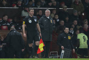 Photo - Manchester United's manager Sir Alex Ferguson speaks to linesman Jake Collin during his team's 4-3 win over Newcastle United in their English Premier League soccer match at Old Trafford Stadium, Manchester, England, Wednesday Dec. 26, 2012. (AP Photo/Jon Super)