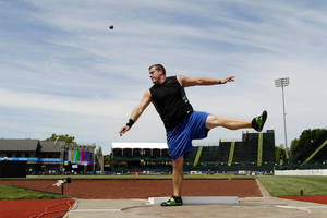 photo - Shot putter Kevin Bookout practices before the U.S. Olympic Track and Field Trials athletics meet, Thursday, June 21, 2012, in Eugene, Ore. (AP Photo/Marcio Jose Sanchez) ORG XMIT: USTF106