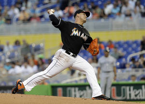 Photo - Miami Marlins' Jose Fernandez pitches against the San Diego Padres in the first inning of a baseball game against the San Diego Padres in Miami, Saturday, April 5, 2014. (AP Photo/Alan Diaz)