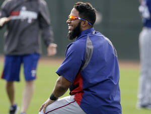 Photo - Texas Rangers' Elvis Andrus laughs with teammates as they stretch before a morning workout during spring training baseball practice, Wednesday, Feb. 19, 2014, in Surprise, Ariz. (AP Photo/Tony Gutierrez)