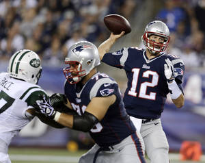 Photo - New England Patriots quarterback Tom Brady (12) passes against the New York Jets in the first quarter of an NFL football game Thursday, Sept. 12, 2013, in Foxborough, Mass. (AP Photo/Charles Krupa)