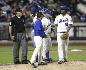 Photo - New York Mets relief pitcher Jenrry Mejia (58) leaves during the eleventh inning of a baseball game against the Milwaukee Brewers, Thursday, June 12, 2014, in New York. (AP Photo/Frank Franklin II)