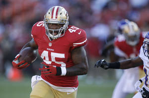 Photo -   FILE - In this Aug. 10, 2012, file photo, San Francisco 49ers running back Brandon Jacobs carries against the Minnesota Vikings during the first quarter of an NFL preseason football game in San Francisco. Last season, Jacobs and Mario Manningham helped the New York Giants win at San Francisco in overtime of the NFC championship on the way to another Super Bowl title. Now, they're in the Bay Area playing for Jim Harbaugh as the defending NFC West champions try to win Sunday's rematch at Candlestick Park. (AP Photo/Ben Margot, File)