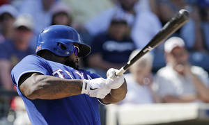 Photo - Texas Rangers' Prince Fielder hits a single during the fifth inning of a spring exhibition baseball game against the Milwaukee Brewers Friday, March 21, 2014, in Surprise, Ariz. (AP Photo/Darron Cummings)