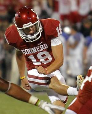 Photo - Oklahoma's Michael Hunnicutt (18) kicks a field goal during the college football game between the University of Oklahoma Sooners ( OU) and the Tulsa University Hurricanes (TU) at the Gaylord Family-Memorial Stadium on Saturday, Sept. 3, 2011, in Norman, Okla. Photo by Chris Landsberger, The Oklahoman ORG XMIT: KOD