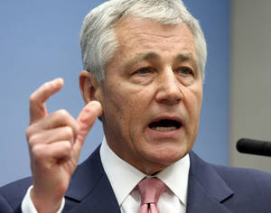 photo - FILE - In this June 26, 2008 file photo, then Sen. Chuck Hagel, R-Neb., speaks on foreign policy at the Brookings Institution in Washington. President Barack Obama may round out his new national security leadership team next week, with a nomination for defense secretary expected and a pick to lead the CIA possible. Hagel is the front-runner for the top Pentagon post. (AP Photo/Lauren Victoria Burke, File)