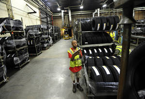 Photo -   FILE-In this Tuesday, July 24, 2012, file photo, forklift driver Clyde Boyce takes inventory in the warehouse at a Michelin tire manufacturing plant in Greenville, S.C. U.S. worker productivity grew at the same modest rate this summer as in spring, a sign that companies may be nearing the limits on how much output they can get from their employees.The Labor Department said Thursday, Nov. 1, 2012, that worker productivity increased at a modest 1.9 percent annual rate from July through September, matching the April-June quarter rate. Labor costs fell at a 0.1 percent rate after having risen at a 1.7 percent rate in the second quarter. (AP Photo/Rainier Ehrhardt, File)